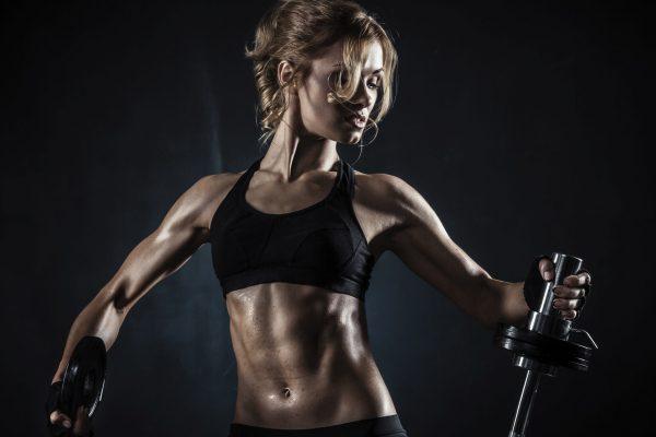 Girl-dumbbells-six-pack-fitness-wallpaper